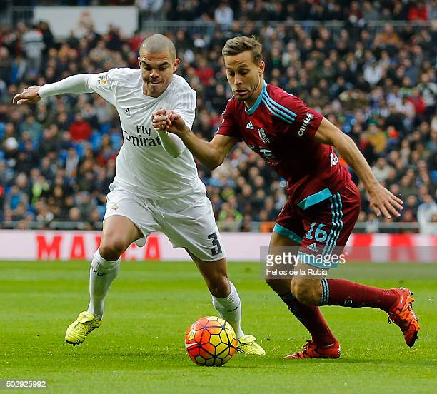 Pepe of Real Madrid and Sergio Canales of Real Sociedad compete for the ball during the La Liga match between Real Madrid CF and Real Sociedad at...