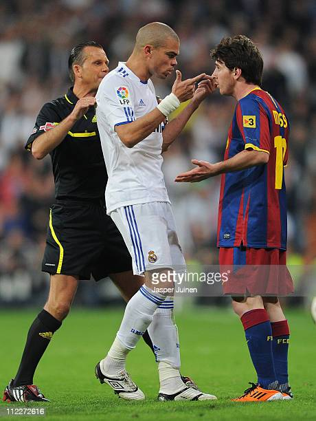 Pepe of Real Madrid argues with Lionel Messi of Barcelona during the la Liga match between Real Madrid and Barcelona at Estadio Santiago Bernabeu on...
