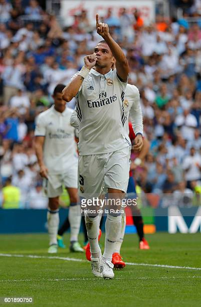 Pepe of Real Madrid celebrates after scoring during the La Liga match between Real Madrid CF and CA Osasuna at Estadio Santiago Bernabeu on September...