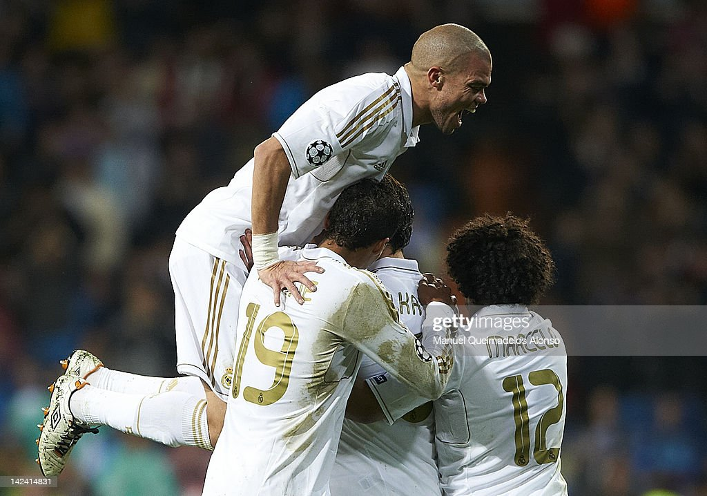 Pepe of Real Madrid celebrates the second goal with his teammates during the UEFA Champions League quarter-final second leg match between Real Madrid and APOEL FC at Bernabeu on April 4, 2012 in Madrid, Spain.