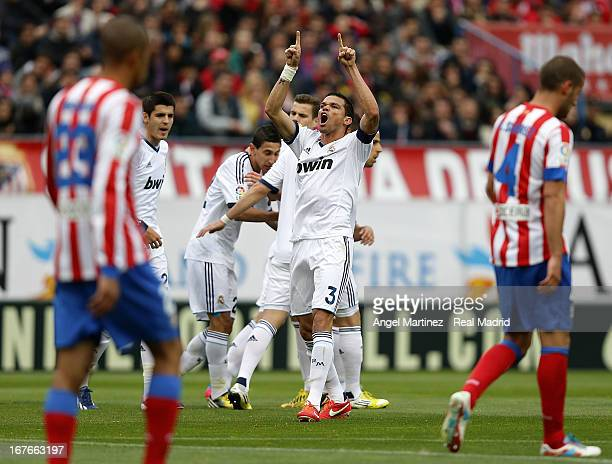 Pepe of Real Madrid celebrates their equalising goal during the La Liga match between Atletico de Madrid and Real Madrid at Vicente Calderon Stadium...