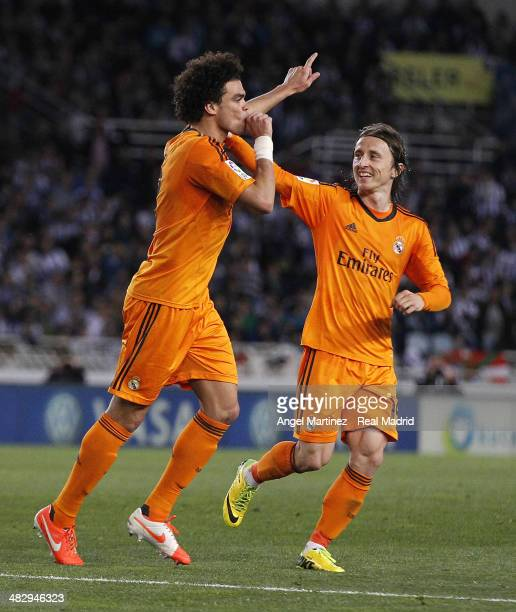 Pepe of Real Madrid celebrates with Luka Modric after scoring their team's third goal during the La Liga match between Real Sociedad and Real Madrid...
