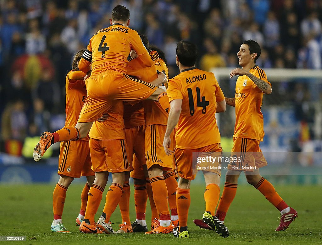 Pepe (C) of Real Madrid celebrates with team mates after scoring the opening goal during the La Liga match between RCD Espanyol and Real Madrid at Cornella-El Prat Stadium on January 12, 2014 in Barcelona, Spain.