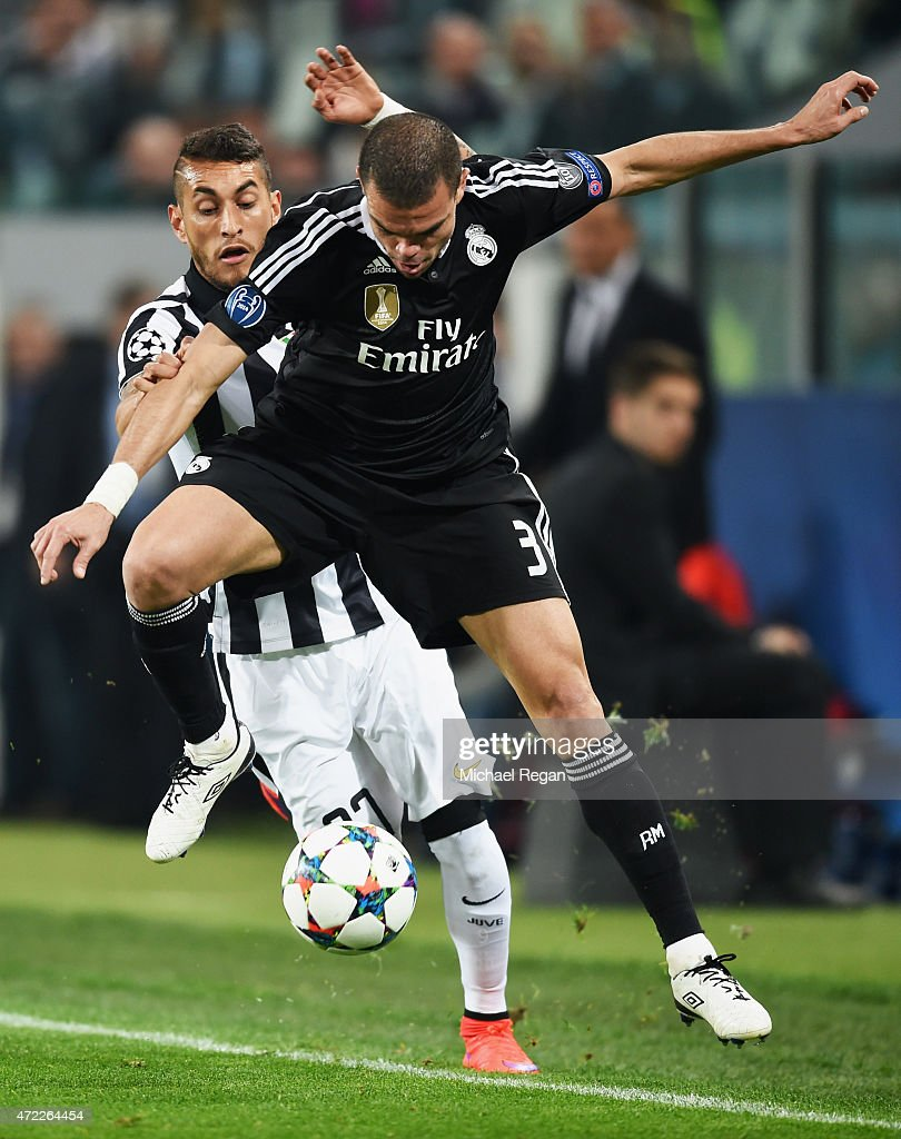 Pepe of Real Madrid CF battles with Roberto Pereyra of Juventus during the UEFA Champions League semi final first leg match between Juventus and Real Madrid CF at Juventus Arena on May 5, 2015 in Turin, Italy.