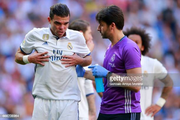 Pepe of Real Madrid CF grimmaces in pain after being tackled by his teammate Toni Kroos during the La Liga match between Real Madrid CF and Club...