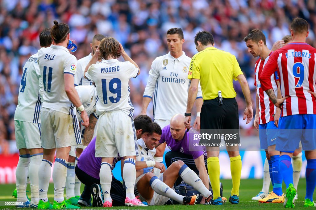 Pepe (2ndL) of Real Madrid CF grimmaces in pain after clashing with his teammate Toni Kroos (R) during the La Liga match between Real Madrid CF and Club Atletico de Madrid at Estadio Santiago Bernabeu on April 8, 2017 in Madrid, Spain.