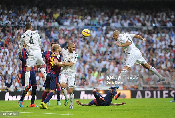 Pepe of Real Madrid CF scores his team's 2nd goal from the penalty spot during the La Liga match between Real Madrid CF and FC Barcelona at Estadio...