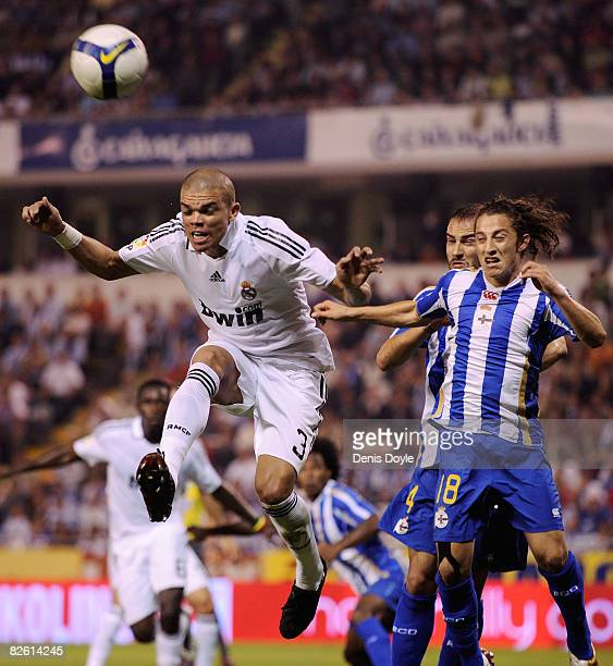 Pepe of Real Madrid heads the ball beside Andres Guardado of Deportivo La Coruna during the La Liga match between Deportivo La Coruna and Real Madrid...