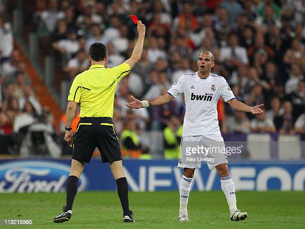 Pepe of Real Madrid is sent off by Wolfgang Stark during the UEFA Champions League Semi Final first leg match between Real Madrid and Barcelona at...