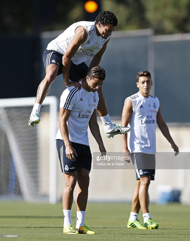 Real madrid training and cristiano ronaldo press conference pepe l of real madrid jumps over cristiano ronaldo during a training session at voltagebd Gallery