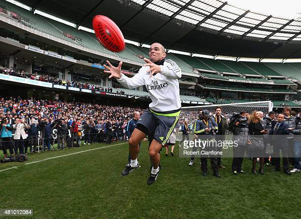 Pepe of Real Madrid marks an Australian Rules football during a Real Madrid training session at Melbourne Cricket Ground on July 17 2015 in Melbourne...