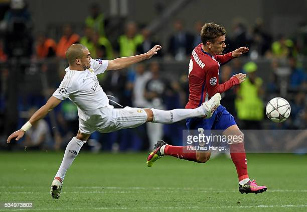 Pepe of Real Madrid stretches to stop the run of Antoine Griezmann of Atletico Madrid during the UEFA Champions League Final match between Real...