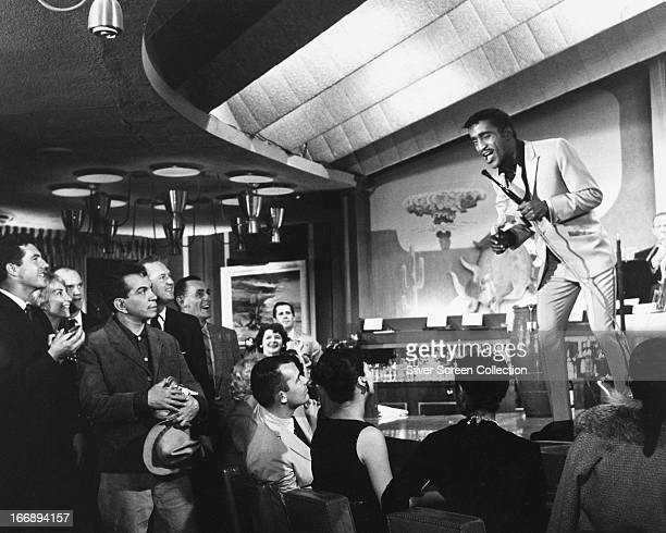 Pepe played by Mexican actor and comedian Cantinflas in the audience during a performance by Sammy Davis Jr as himself in 'Pepe' directed by George...