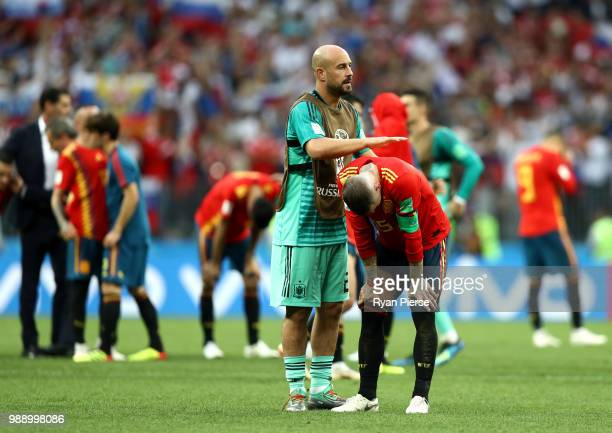 Pepe Reina consoles team mate Sergio Ramos of Spain following the 2018 FIFA World Cup Russia Round of 16 match between Spain and Russia at Luzhniki...