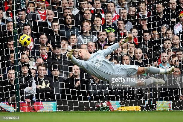 Pepe Reina goalkeeper of Liverpool fails to stop the shot of Scott Parker of West Ham during the Barclays Premier League match between West Ham...