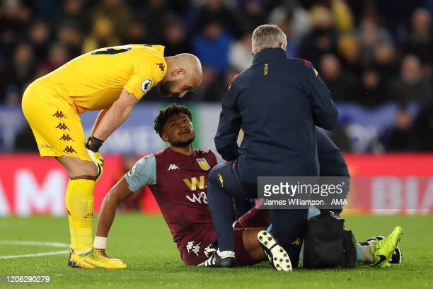 Pepe Reina in discussion with Tyrone Mings of Aston Villa while he receives treatment during the Premier League match between Leicester City and...