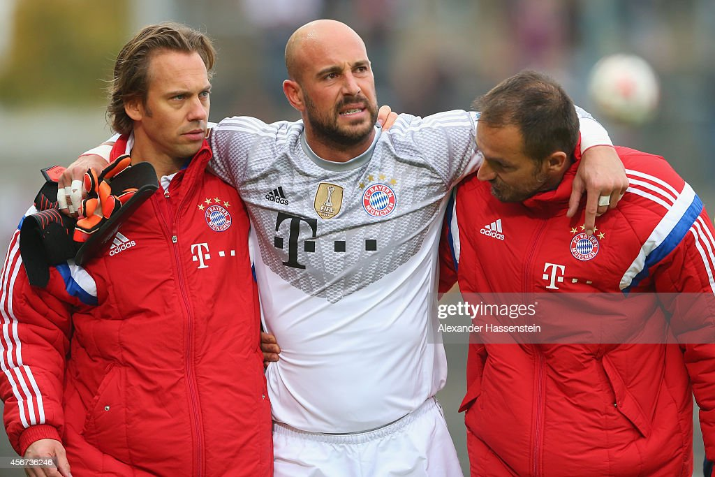Pepe Reina, keeper of Muenchen receives medical treatment after getting injured during the Finale of the Paulaner Cup 2014 between FC Bayern Muenchen and Paulaner Traumelf at Alpenbauer Sportpark on October 6, 2014 in Unterhaching, Germany.