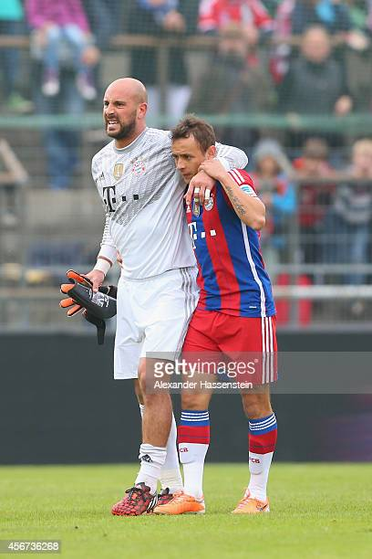 Pepe Reina keeper of Muenchen receives medical treatment from his team mate Rafinha after getting injured during the Finale of the Paulaner Cup 2014...