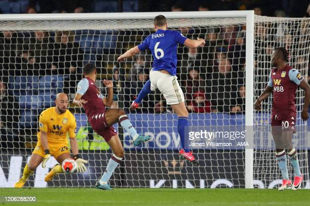 Pepe Reina of Aston Villa saves the header of Jonny Evans of Leicester City during the Premier League match between Leicester City and Aston Villa at...