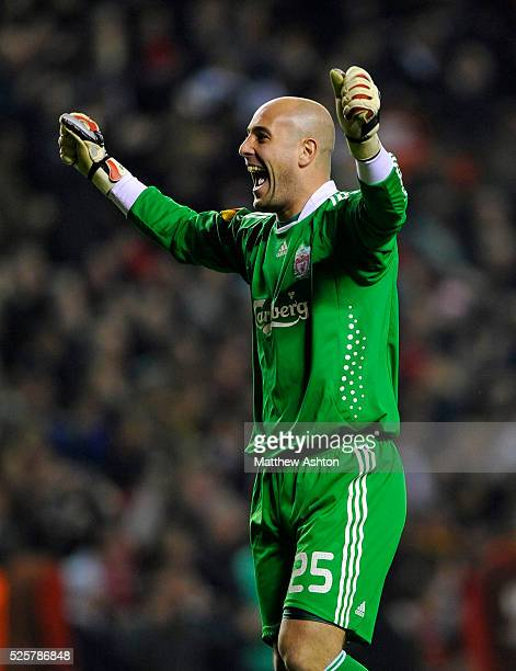Pepe Reina of Liverpool celebrates after his team defeat Lille