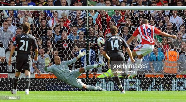 Pepe Reina of Liverpool fails to save a penilty shot from Jonathan Walters of Stoke City during the Barclays Premier League match between Stoke City...