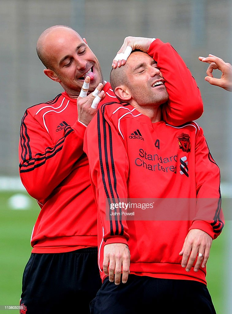 Pepe Reina (L) of Liverpool flicks team mate Raul Meireles' ear during a Liverpool training session at Melwood Training Ground on May 6, 2011 in Liverpool, England.