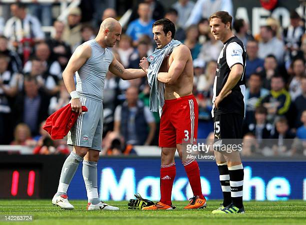 Pepe Reina of Liverpool gives the goalie shirt to team mate Jose Enrique after being sent off by Referee Martin Atkinson during the Barclays Premier...
