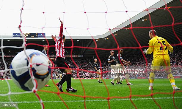 Pepe Reina of Liverpool is rooted to the spot as Darren Bent of Sunderland scores during the Barclays Premier League match between Sunderland and...