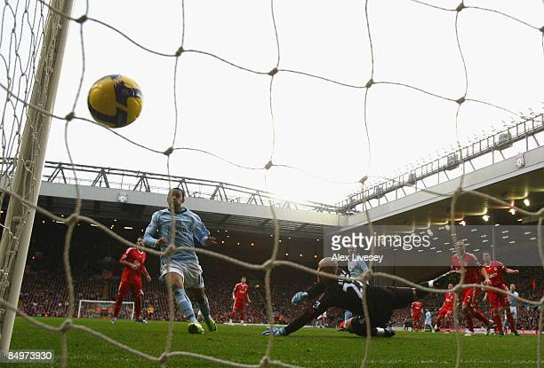 Pepe Reina of Liverpool is unable to stop Craig Bellamy of Manchester City scoring the opening goal during the Barclays Premier League match between...