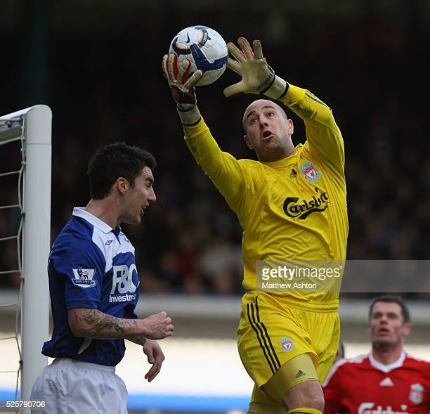 Pepe Reina of Liverpool saves a shot from Liam Ridgewell of Birmingham City
