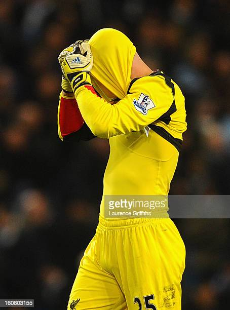 Pepe Reina of Liverpool shows his frustration during the Barclays Premier League match between Manchester City and Liverpool at the Etihad Stadium on...