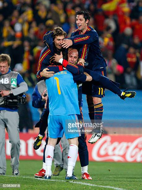 Pepe Reina of Spain and his team mates celebrate with Iker Casillas of Spain at the end of the match after they qualify for the semifinals of the...