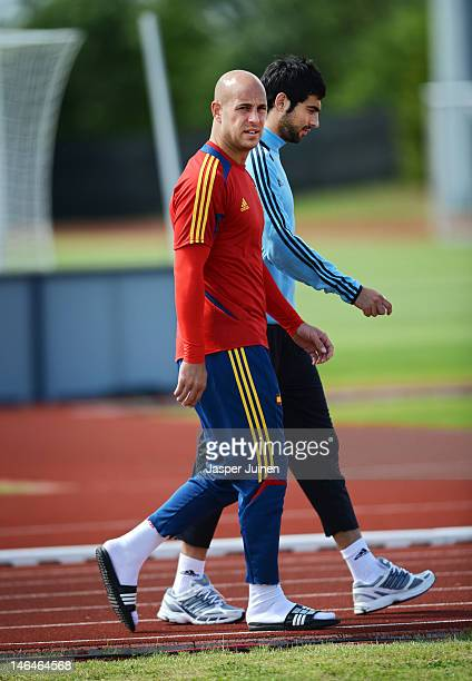 Pepe Reina of Spain arrives for a training session with his teammate Raul Albiol ahead of their UEFA EURO 2012 group C match against Croatia on June...