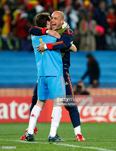 Pepe Reina of Spain celebrates with Iker Casillas of Spain at the end of the match after they qualify for the semifinals of the 2010 FIFA World Cup