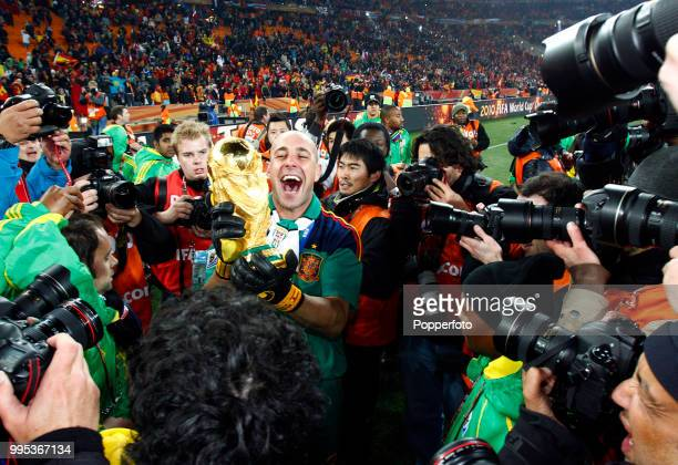Pepe Reina of Spain celebrates with the trophy after the FIFA World Cup Final between the Netherlands and Spain on July 11 2010 in Johannesburg South...