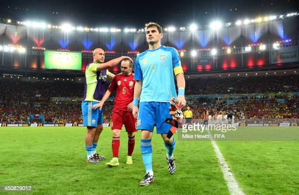 Pepe Reina of Spain consoles Andres Iniesta and Iker Casillas as they walk off the pitch during the 2014 FIFA World Cup Brazil Group B match between...