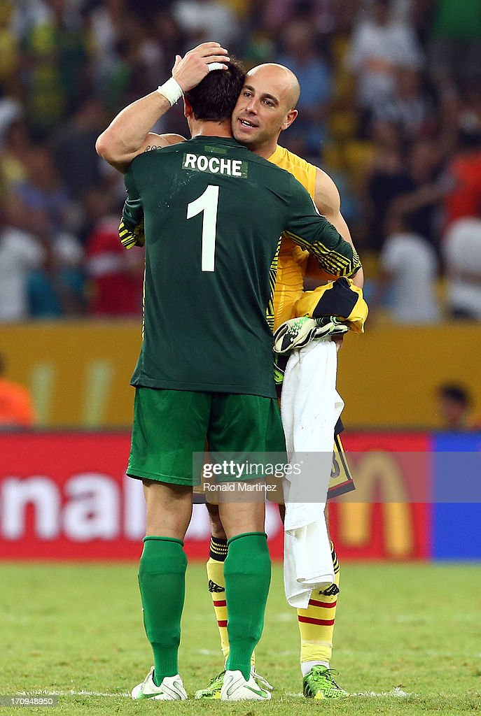 Pepe Reina of Spain embraces Mickael Roche of Tahiti at the end of the FIFA Confederations Cup Brazil 2013 Group B match between Spain and Tahiti at the Maracana Stadium on June 20, 2013 in Rio de Janeiro, Brazil.