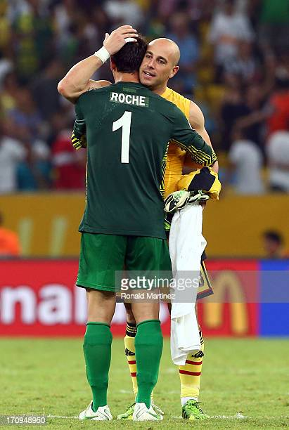 Pepe Reina of Spain embraces Mickael Roche of Tahiti at the end of the FIFA Confederations Cup Brazil 2013 Group B match between Spain and Tahiti at...