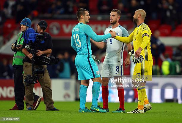 Pepe Reina of Spain shakes the hand of England goalkeeper Tom Heaton as Jordan Henderson of England looks on after the International Friendly match...