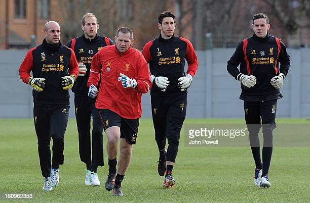 Pepe Reina Peter Gulacsi Brad Jones and Danny Ward follow John Achterberg of Liverpool during a training session at Melwood Training Ground on...
