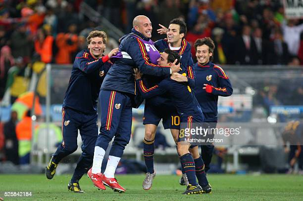 Pepe Reina Xavi and Cesc Fabregas of Spain celebrate at the end of the match after winning the 2010 FIFA World Cup