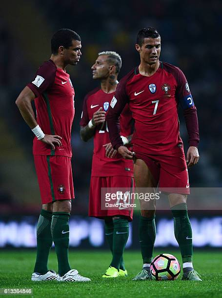 Pepe Ricardo Quaresma and Cristiano Ronaldo of Portugal look on during the FIFA 2018 World Cup Qualifier between Portugal and Andorra at Estadio...
