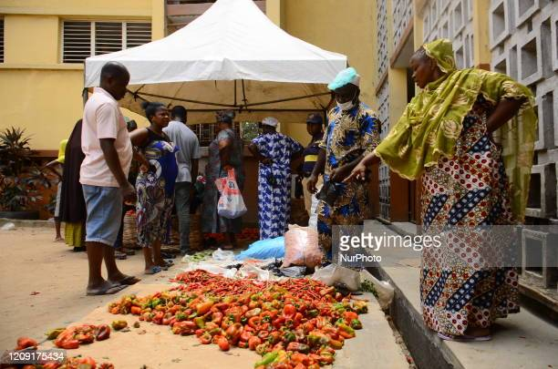 A peper vendor attends to buyer at a Primary School converted for a temporary makeshift food market established by Lagos State government for...