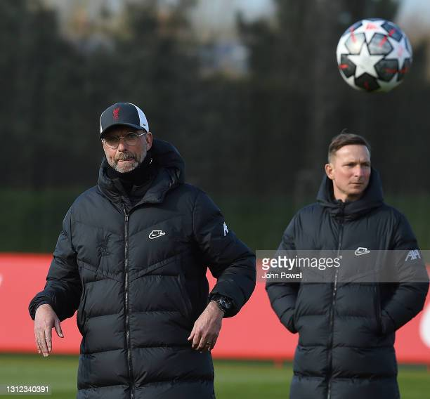 Pepijn Lijnders and Jurgen Klopp manager of Liverpool during a training session at AXA Training Centre on April 13, 2021 in Kirkby, England.