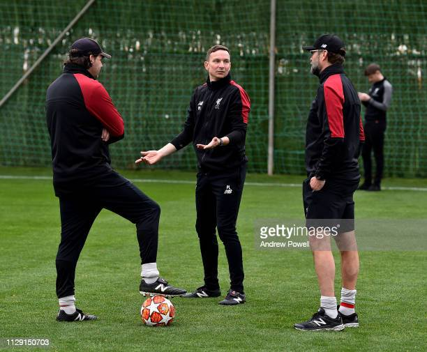 Pepijn Lijnders assistant manager of Liverpool talking with Peter Krawietz assistant manager and Jurgen Klopp manager during a training session on...