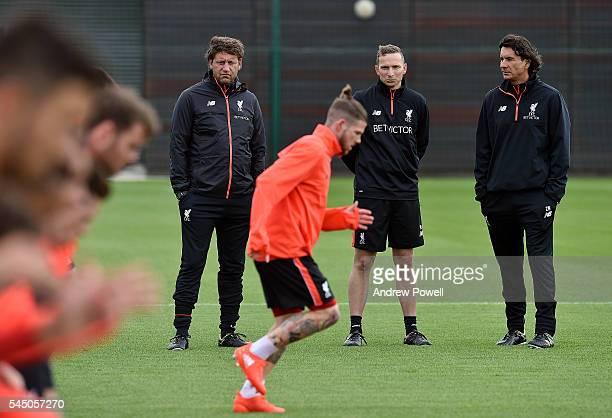 Pepijn Lijnders Firstteam development coach of Liverpool with Peter Krawietz Second assistant coach and Zeljko Buvac first team coach during a...