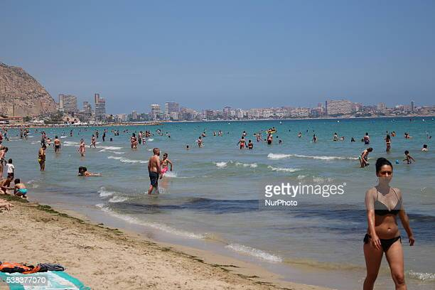 Peple enjoy hot and sunny weather in the coastal resort of Alicante Spain on June 5 2016 Many of citizens and tourists enjoy sunbathing swimming in...