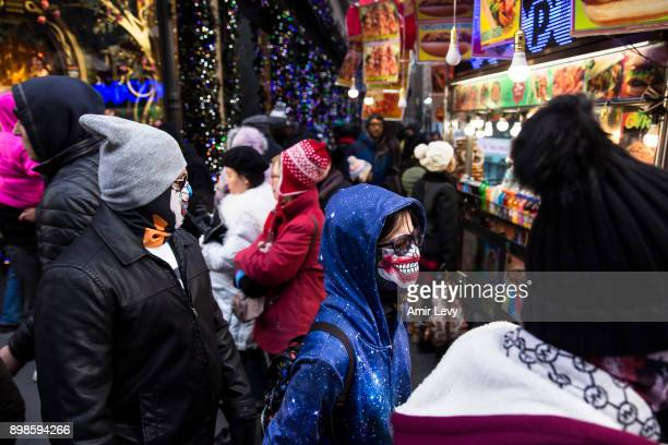 Pepole walk by a store decoration on Fifth Avenue on Christmas day on December 25 2017 in New York City Security in New York is on alert as thousand...