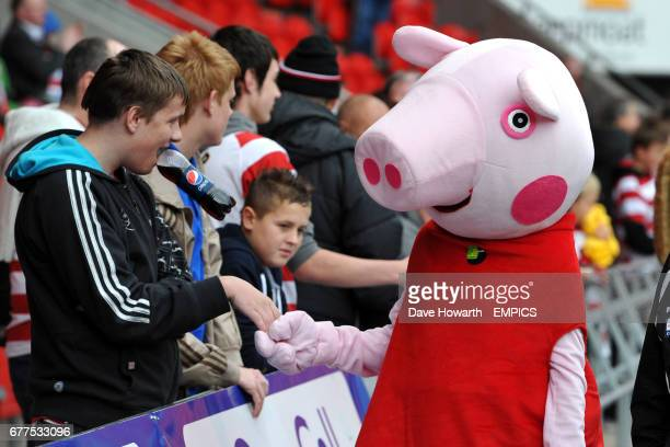 Peppa Pig shakes hands with fans in the stands