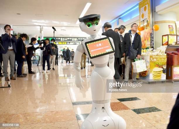 Pepper a humanoid robot developed by SoftBank Group Corp wearing Microsoft Corp's computer glasses HoloLens on its head moves around on its own to...